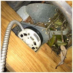 Ventilator fan jammed up with debris - this was an animals den/nest adn this can be a serious fire hazard!