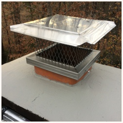 Chimney cap repair: Stainless chimney cap installed to prevent more squirrel and birds in the fireplace. The crown has been sealed to prevent moisture damage.